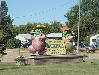Vauxhall, Alberta - Town mascots Sammy and Samantha Spud, two potatoes dressed as farmers, greeting northbound travellers into Vauxhall