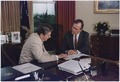 Vice President Bush and President Reagan working in the Oval Office - NARA - 186367.tif