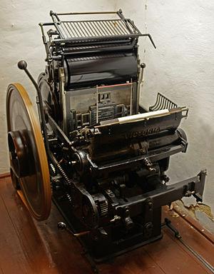 Jobbing press - A platen jobbing press in operation
