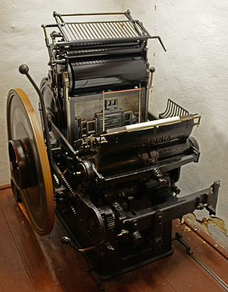 Jobbing press - A platen jobbing press in operation
