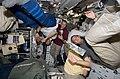 View of STS-125 Crew Members in the Middeck (28136528622).jpg