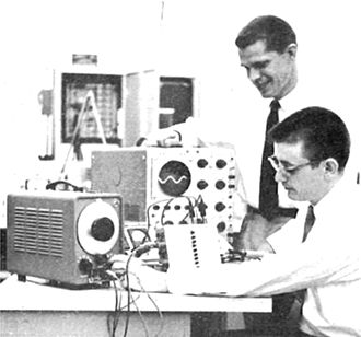 James R. Biard - Walter T. Matzen (top) and James R. Biard (bottom) demonstrate a low-drift DC differential amplifier at TI in 1958.