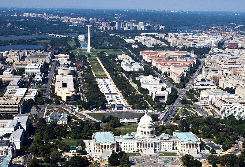 An aerial photo of Washington, DC. Many notable landmarks are in view, including the Capitol Building and the Washington Monument.