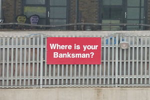 Banksman - A safety reminder displayed at an industrial site near London Paddington station.