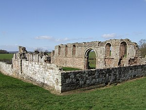 White Ladies Priory - The view from the south-east. The large arch marks the entrance to the north transept. To the left of it can be seen the nave north wall and windows; to the right the chancel.