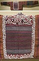 Woman's jacket from Sumatra, Indonesia, late 19th century, cotton, mirrorwork and shells, HAA.jpg