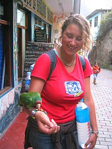 Woman playing with a parrot in Peru-8Dec05.jpg