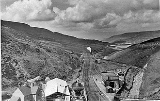 Woodhead line - The line in 1951 before electrification, looking westwards from above Woodhead Tunnel. Woodhead railway station is visible in the foreground.