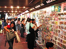 Filipino labourers are the major source of domestic helpers in Hong Kong. The photo shows Filipinos selling and purchasing pirated VCDs in Worldwide Plaza, Central.