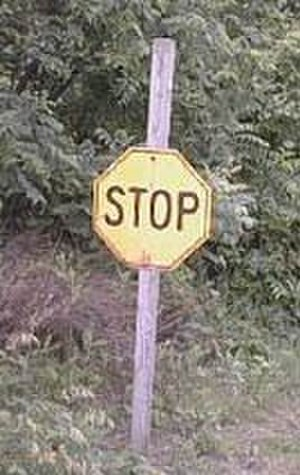Stop sign - Yellow 1924–1954 stop sign. Mounting height is typical.