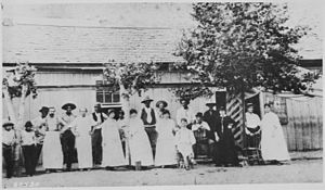 Dance hall - Dance halls were common in the Old West. This photograph shows customers and staff at Hovey's Dance Hall in Clifton, Arizona, in 1884. The famous author Anton Mazzanovich is standing next to the tree at right.