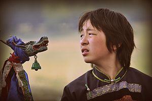 Shamanism in Siberia - A Buryat  boy in a shaman ritual