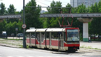 Moscow Monorail - Tram line 17 passes under the monorail track near the VDNKh Moscow Metro station