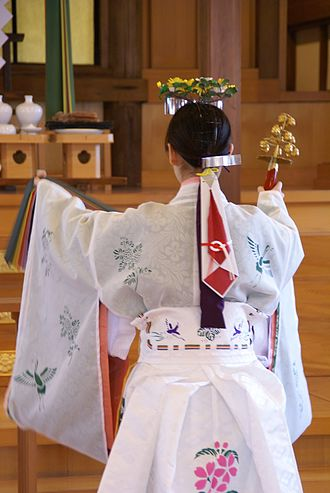 Suzu - Shinto priestess with suzu bells in her right hand