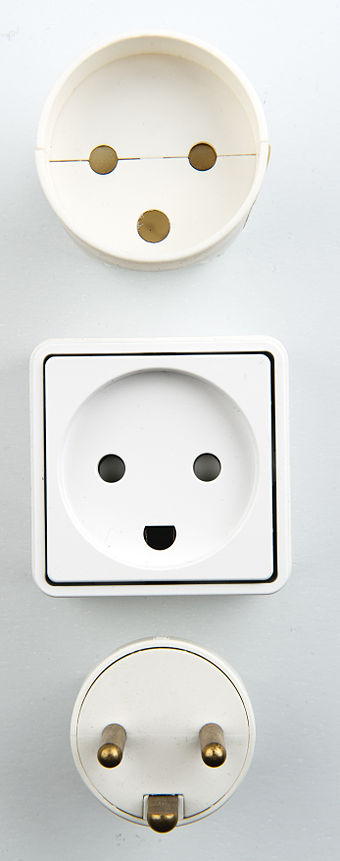 Danish 107-2-D1, standard DK 2-1a, with round power pins and half round earth pin 107-2-D1 - Danish electrical plugs - Studio 2011.jpg