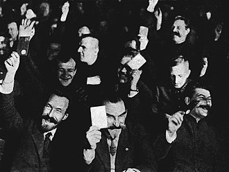 Central Committee elected by the 15th Congress of the All-Union Communist Party (Bolsheviks) - The 15th Party Congress; in the foreground Alexei Rykov, Mykola Skrypnyk and Joseph Stalin raising their membership cards.