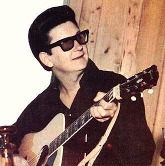 "Roy Orbison - Orbison began performing while wearing sunglasses in 1963, later recalling that he ""wasn't trying to be weird ...  I didn't have a manager who told me to dress or how to present myself or anything, but the image developed of a man of mystery and a quiet man in black somewhat of a recluse, although I never was, really."""