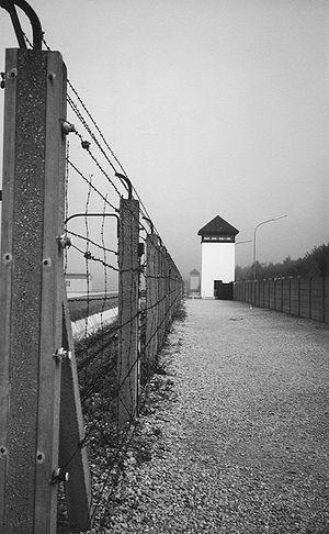 Postenpflicht - Fence and guard watch tower at Dachau