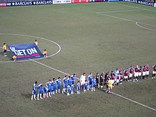 Aston Villa and Chelsea players line up on the pitch ahead of the 2011 final.