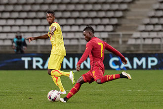 Christian Atsu - Atsu on the ball in a friendly against Mali in Paris in March 2015
