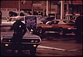 A-police-officer-in-portland-controlled-traffic-at-a-gasoline-station-that-was-limiting-its-sales-to-only-two-gallons-per-customer-in-december-1973-121973 4272499506 o.jpg