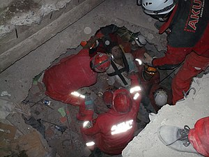2011 Van earthquakes - A rescue operation being carried out by members of the AKUT Search and Rescue Association.