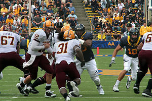 ASU quarterback Rudy Carpenter hands off to ta...