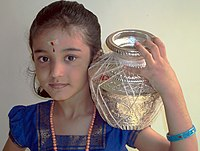 A Hindu girl in traditional dress for the Tamil Pongal festival.jpg