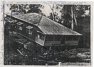 Enoggera Creek - A House Crosses the Creek