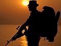 A Marine on guard duty taking part in Exercise Green Osprey in Senegal, he is shown in silhouette against the setting sun. MOD 45145992.jpg