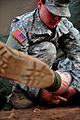 A U.S. Army medic treats a Soldier with simulated wounds during a medical exercise for Austere Challenge 2012 in Beit Ezra, Israel 121022-F-QW942-049.jpg