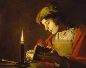 A Young Man Reading at Candlelight