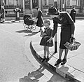 A mother teaches her daughter to cross the road in safety during 1942. D7807.jpg