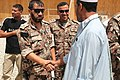 A participant in the Voices of Moderate Islam Initiative is greeted by a Jordanian soldier at Forward Operating Base (FOB) Shank, Logar province, Afghanistan, Aug 100825-A-CA126-118.jpg