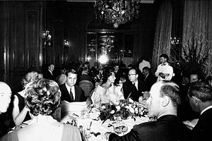 Tout-Paris - A dinner for fashion designer Charles Jourdan at the trendy Plaza Athénée hotel in Paris, 1962.