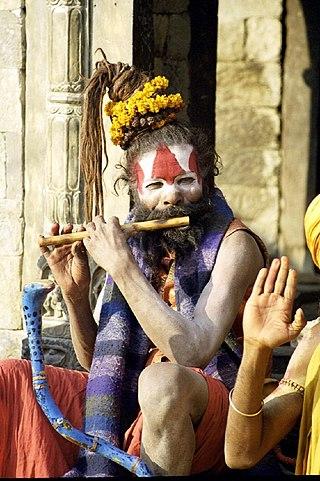 A sadhu playing flute, Benaras.jpg