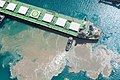 A ship being pushed sideways in Croatia. It stirs up some mud (20063729610).jpg