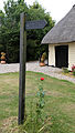 Abbess Beauchamp and Berners Roding, Essex England - fingerpost with poppy 02.JPG