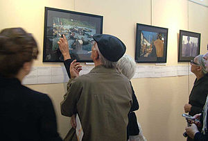 Ethnic cleansing of Georgians in Abkhazia - A visitor at a gallery recognizes her dead son in a photograph on the 12th anniversary of the ethnic cleansing in Abkhazia, 2005.