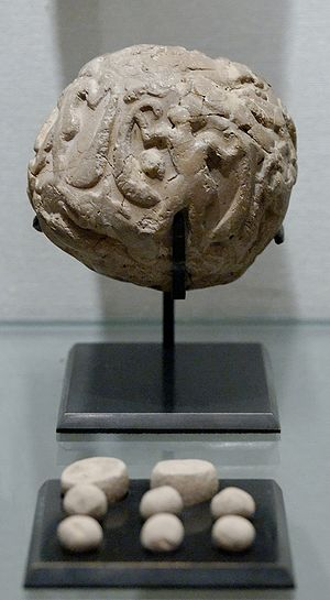 Bulla (seal) - A bulla (or clay envelope) and its contents on display at the Louvre. Uruk period (4000 BC–3100 BC).