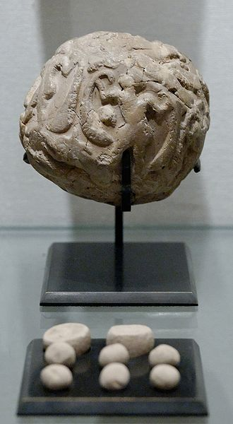 Susa - Globular envelope with the accounting tokens. Clay, Uruk period (c. 3500 BCE). From the Tell of the Acropolis in Susa. The Louvre