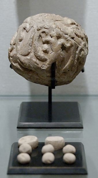 Globular envelope (known as a Bulla) with a cluster of accountancy tokens, Uruk period, 4000-3100 B.C.E, from Susa. Louvre Museum Accountancy clay envelope Louvre Sb1932.jpg