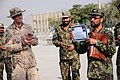 Afghan Air Force Colonel Faizuddin holds a certificate during a ceremony at on the base in Kabu.jpg