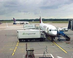 Gate Gourmet - A Gate Gourmet catering truck servicing an Air Berlin aircraft at Hamburg Airport