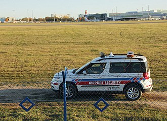 Airport security - Airport security car patrolling perimeters of the restricted area.