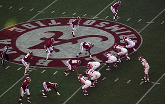 2011 Alabama Crimson Tide football team - The Crimson Tide defense awaits the Tyler Wilson snap for the Razorbacks at midfield.