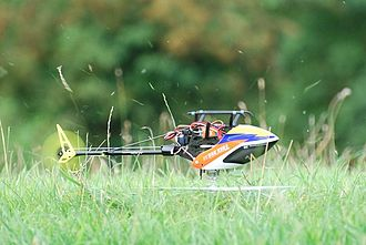 Radio-controlled helicopter - Electric Trex 250 micro heli flying inverted