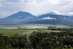 A view of Mount Merbabu, Telomoyo and Lake Rawapening from Ambarawa.