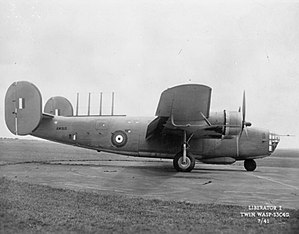 Consolidated Liberator I - Liberator Mk. 1 AM910. The antenna for its ASV radar are fitted to the top of the fuselage. The forward half of the bomb-bay is sealed up and a blister, containing four 20mm cannon, is fitted underneath it (July 1941)