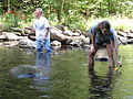 Ann McGhee and Lily Cason measuring stream velocity (4977000389).jpg